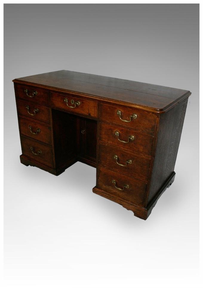 A George III oak Kneehole Desk with swanneck handles, circa 1780.  (43x20.5x27.5h) £1450. - Antique Desks, Library Tables And Bureaux
