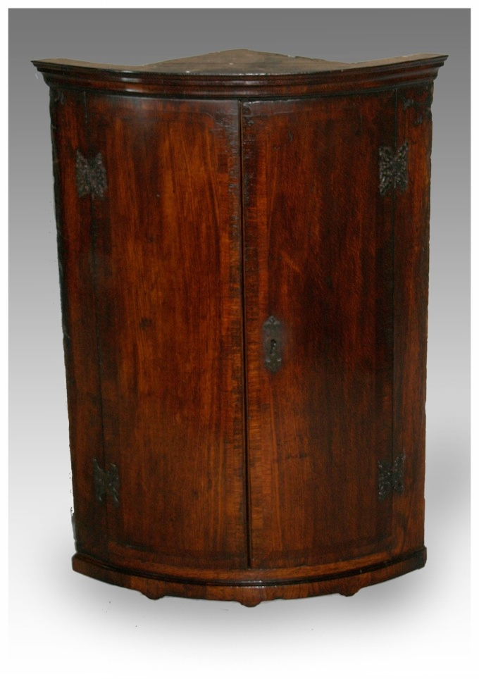 A George III Bow fronted Oak and banded Hanging Corner Cupboard, circa  1780. (25.5x35h) £850. - Corner CupboardsMarcus Moore Antiques Sells Antique Furniture