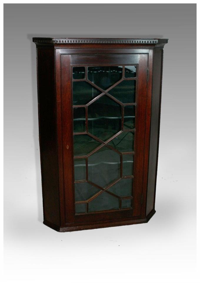 Delicieux A George III Mahogany Glazed Hanging Corner Cupboard, Circa 1790.  (28.75x42.5h) £950.