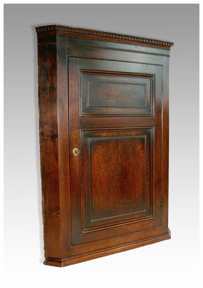 A George III twin panelled oak Hanging Corner Cupboard, circa 1790.  (31x42h) £595. - Corner Cupboards